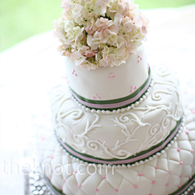 Deanne and Will cut into a gorgeous three-tiered confection decorated in quilted fondant, pink dots, and pink and green ribbon. A cluster of pink and green hydrangeas topped the cake.