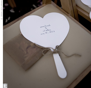 To keep guests cool under the Georgia sun, the couple placed heart-shaped fans, printed with their wedding date, on the chairs.