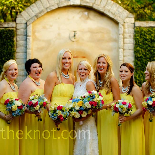 Rebecca's dream wedding evolved from the bright yellow, empire waist bridesmaids' dresses she had envisioned of all her life. The ladies carried smaller, multicolored bouquets to complement the color scheme in the bridal bouquet.