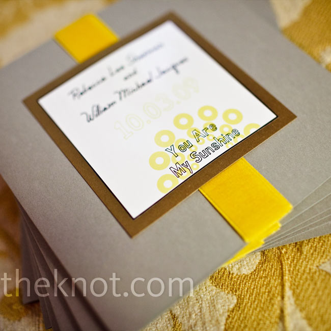 The couple used card stock and vinyl stickers to make their own ceremony programs. They replicated the font, colors, and graphic design images of the wedding invitations to keep the look cohesive.