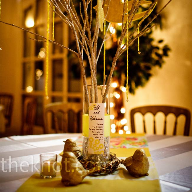 After the holidays, the couple scored a great deal on the glittery gold branches that inspired their DIY centerpieces. With a miniature nest base and golden birds, each arrangement was personalized with a hand-stamped wedding label.