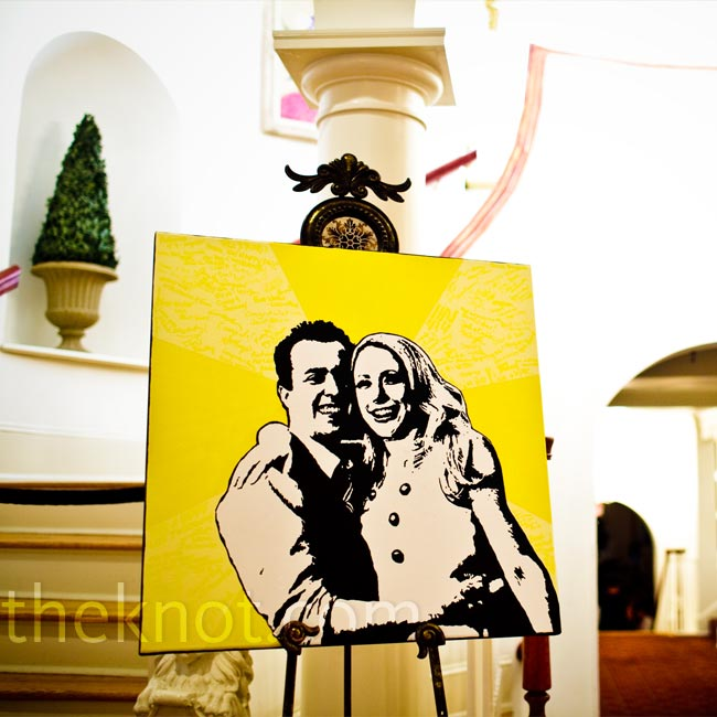 "Instead of a traditional guest book, the bride painted a portrait of the couples' engagement photo in her signature pop art-style and let the guests sign it with yellow paint pens. ""You can see the messages up close, but from far away it looks like subtle texture,"" says Rebecca."