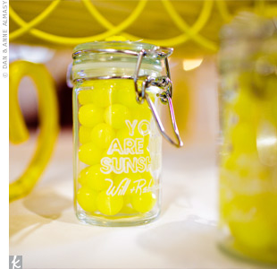 The couple raided every Cost Plus World Market store in the Atlanta area for their mini-glass favor jars. They filled them with Lemonheads and personalized them with their wedding signature.