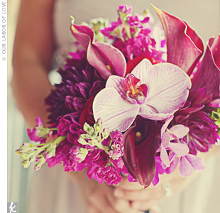 To pull the deeper shades of the day into their look, Sydney's bridesmaids carried monochromatic bouquets of fuchsia roses, dahlias, dendrobium orchids, and calla lilies.