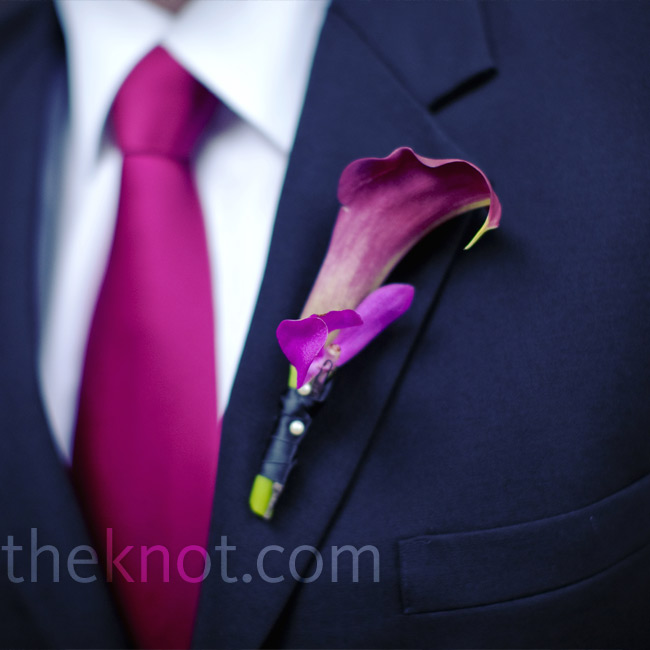 Purple calla lilies matched the groomsmen's ties and added the perfect pop of color to their black jackets.