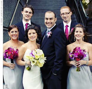 The bridesmaids wore strapless, silk-chiffon dresses with silver detailing. The men wore classic black suits, with ties to match the fuchsia bouquets.