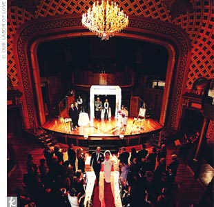 Sydney and Chris said their vows on Opera's dramatic stage, beneath a huppah draped in ivory satin.
