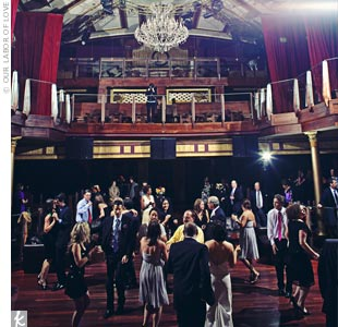 Opera Atlanta was built in the 1920s -- a perfect backdrop to the couple's vintage wedding. The lavender lip phalaenopsis orchid inspired their color scheme -- silver, black, and cream with pops of dark fuchsia.
