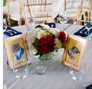Framed animal prints from Etsy sat next to centerpieces with the same types of flowers as the bride's bouquet.
