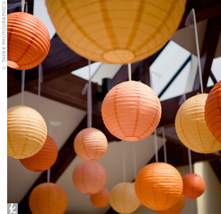 The multihued paper lanterns that hung from the ceiling of the reception space were one of Laura's favorite aspects of her wedding -- there were 200 total!