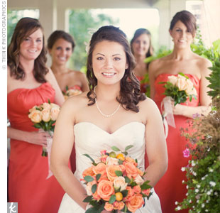 Laura's citrus-colored bridal bouquet was made up of orange and peach roses accented with fresh kumquats. The bridesmaids carried similar bouquets of peach roses, which nicely complemented their mango-colored dresses.
