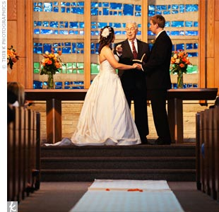 "Rich wood interiors and floor-to-ceiling glass windows provided plenty of decoration for the traditional ceremony. The couple said ""I do"" in the same chapel where the bride's father and stepmother had married 20 years earlier!"