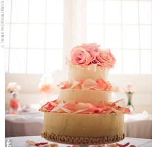 A family friend made the wedding cake, and the florists spruced it up with a few fresh rose petals. A cluster of paper lanterns hung over the cake table for a pop of color.