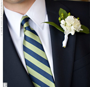 For a clean look, the boutonnieres were made with hydrangeas, hypericum berries and lemon leaves. Ben stood out with white hydrangeas while his groomsmen wore green.
