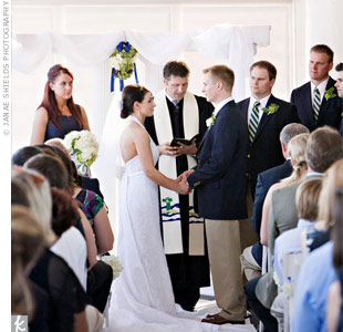 Amanda and Ben got married in the yacht club's sunroom, surrounded by great views of the San Francisco Bay. A single flower arrangement decorated the altar.
