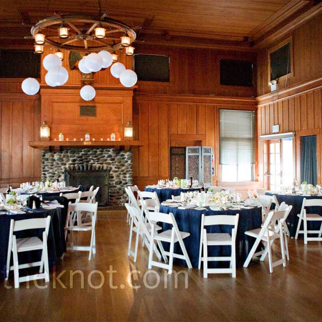 Rather than mask all the historic sailing elements in the yacht club's grand ballroom, Amanda and Ben embraced it. White paper lanterns hung from the historic chandeliers, adding a fun, modern touch.