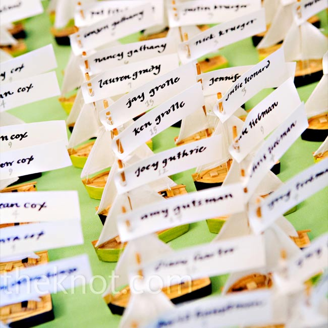 Instead of traditional cards, Amanda and Ben bought mini sailboats and tagged them with guests' names and table numbers.