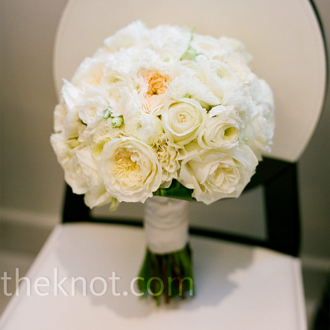Christine carried a bouquet of garden roses. It was oversized -- just the way she wanted it.