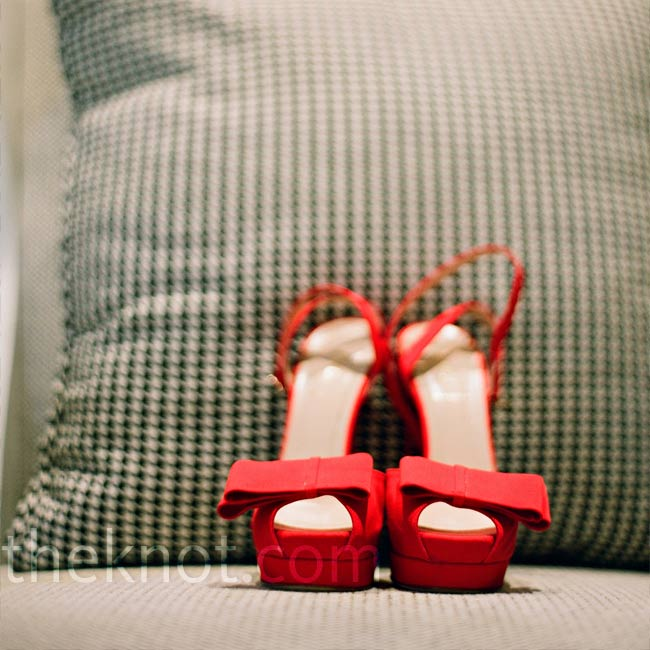 Somehow, Christine made it through the night wearing five-inch (Fendi!) heels. They were bright red and matched the day's décor perfectly.