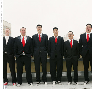 The six groomsmen wore black suits, which they already owned, and matching red ties. Brian gave them each a pair of black leather Converse sneakers with their names stitched on the backs.