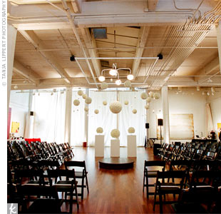 Since the ceremony space doubled as the reception space (white linens separated the rooms during the service), the decorations could be left up all night. The only change: The largest white ball from the ceremony was swapped out for a red one, signifying it was time to party!