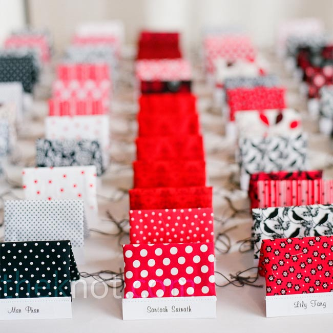 Tented cards were draped with homemade fabric bags, which guests could later fill with goodies from the candy bar.