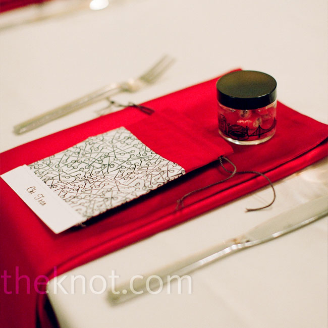 Red napkins popped against ivory table linens. Dinner was served on black and white square plates.