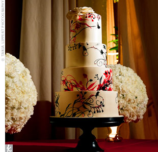 The baker suggested mimicking the invitation design on the cake to bring the event full circle; guests saw the invitations first and the cake was one of the last! The fourth tier was topped with a sugar replica of Christine's floral headpiece.
