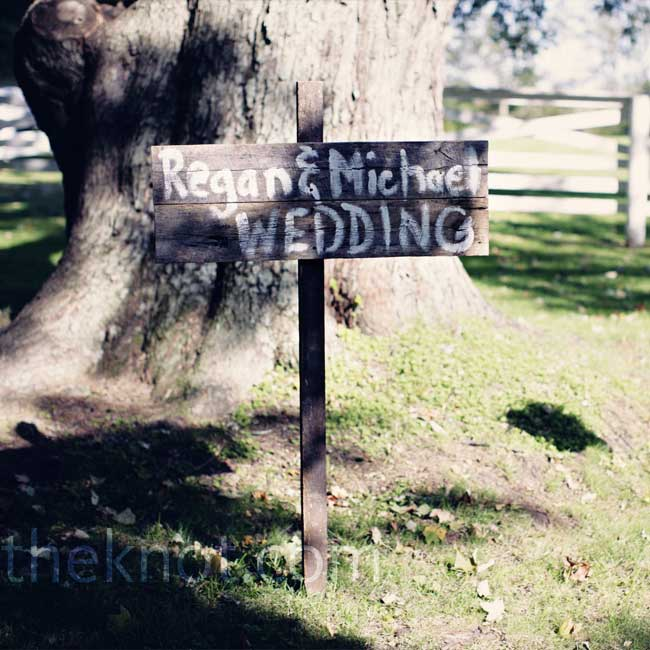 Jacki and Jaime of Jacki Allen Wedding Planning gave the couple this rustic wedding sign crafted out of Kentucky barn wood.