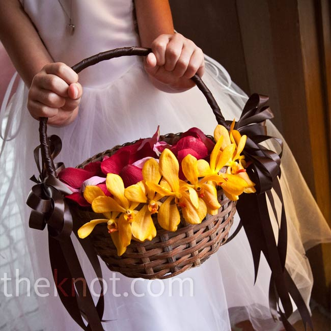 Chris' niece Kylen, the flower girl, carried a basket decorated with mini calla lilies to match the groomsmen bouts and filled with silk rose petals. The ceremony site, a historic landmark, doesn't allow fresh flowers to be thrown.