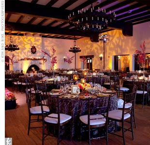 Up-lighting branches onto the walls created a romantic, fall atmosphere in the reception space. Mimi and Chris set at an elevated and spotlighted sweetheart table.
