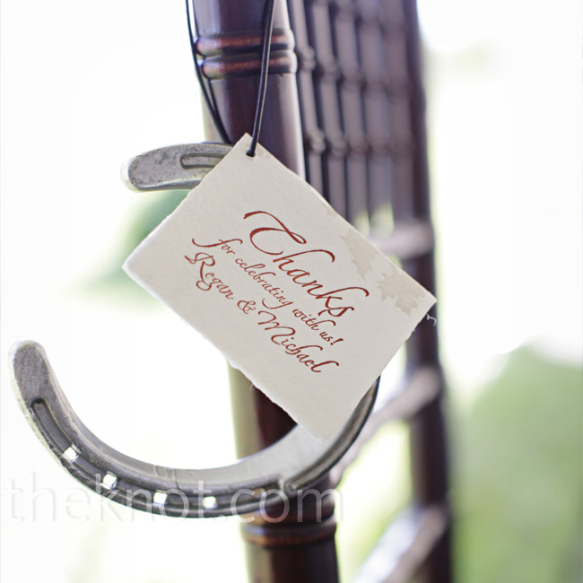 For a year, Regan and Michael had a local farrier (someone who shoes horses) collect old horseshoes from local Kentucky farms. At the wedding, each guest received a horseshoe along with a card explaining the tradition of good luck that falls upon those entering a home with a horseshoe hanging over the doorway.