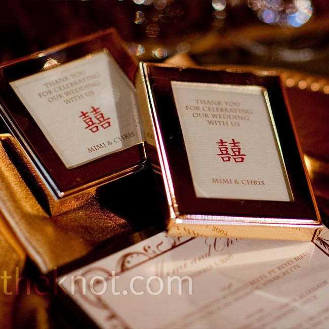 Gold mini-frames with thank-you notes inside were placed on every other seat at the tables. On the remaining seats individually wrapped fortune cookies inside red fabric heart-shaped boxes Mimi's parents brought back from a trip to China.