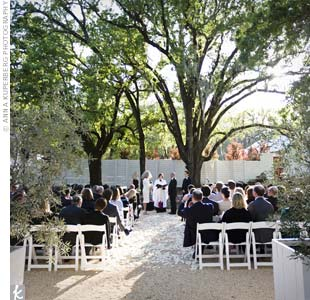 "The wedding party emerged from a small, white cottage located behind the guests. Once everyone was in place, Patricia and Ian said ""I do"" under a sprawling 200-year-old Oak tree."