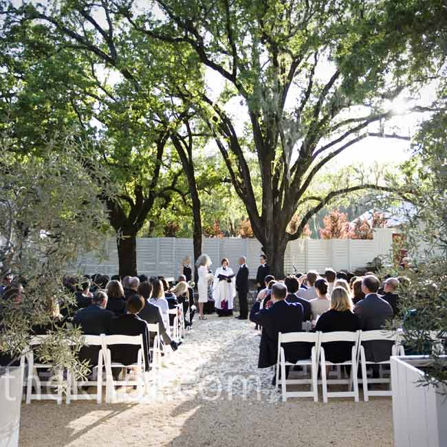"""The wedding party emerged from a small, white cottage located behind the guests. Once everyone was in place, Patricia and Ian said """"I do"""" under a sprawling 200-year-old Oak tree."""