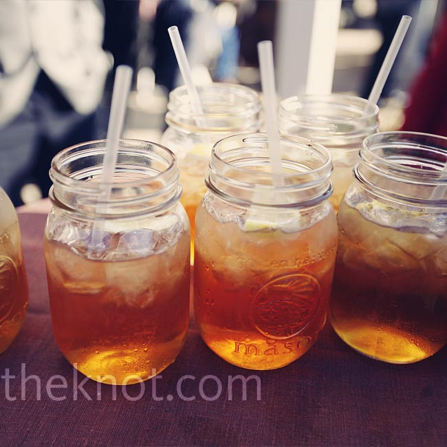 Guests sipped bourbon iced tea in a courtyard surrounded by trees and a stone fence as they listened to Kentucky bluegrass music. The signature drink was such a hit that by the time Regan and Michael got to the reception, there wasn't any left!