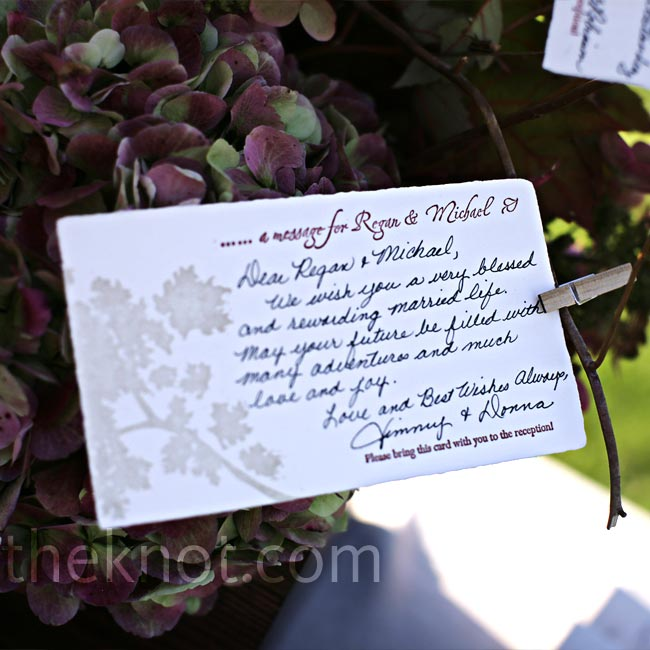 The couple included message cards in their wedding invitations for guests to write a brief wedding day note. The filled-out cards were then displayed in the centerpieces for everyone to read.