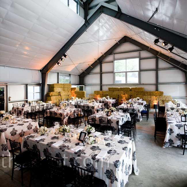 Guests sat at a mix of king tables and smaller square tables -- each one was topped with a black and white damask-patterned linen.