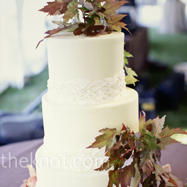 Though their actual dessert was a bourbon bread pudding, Regan and Michael still opted to have a wedding cake for ceremonial purposes. The simple, three-tiered cake was decorated with fall leaves and orchids.
