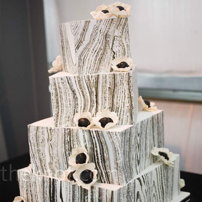 Ian wanted the four-tiered cake to be decorated with a wood grain design, inspired by the organic pattern of the restored wood found inside the property's cottage.