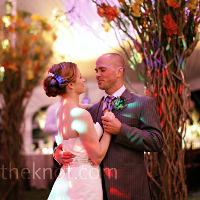 "The bride and groom danced their first dance to ""Heavenly Day"" by Patty Griffin. It was on their first date that they discovered their mutual love for the artist. Regan and Michael also loved how their lighting decor created a ""starry night"" display on the tent ceiling while their guests danced."