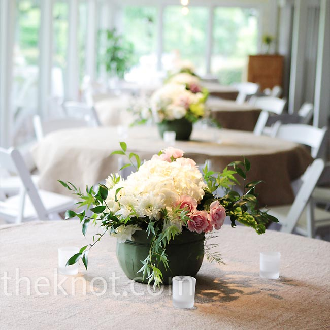Burlap linens and romantic centerpieces of flowers cut from Brandi's grandmother's and parents' yard gave the reception space a rustic, elegant look. Her grandmother arranged the flowers in distressed wood containers.