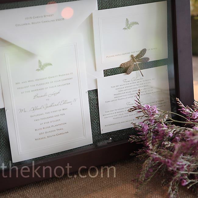 After spending so much time picking out her wedding invitations, Brandi wanted to show them off one more time. She created a shadow box of the stationery and displayed it on the sign-in table.