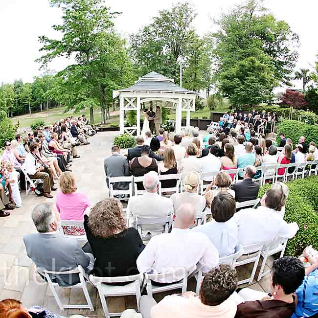 "The couple said their vows in ""the shortest ceremony ever"" (it was 15 minutes including the processional and recessional!) under an intimate gazebo."
