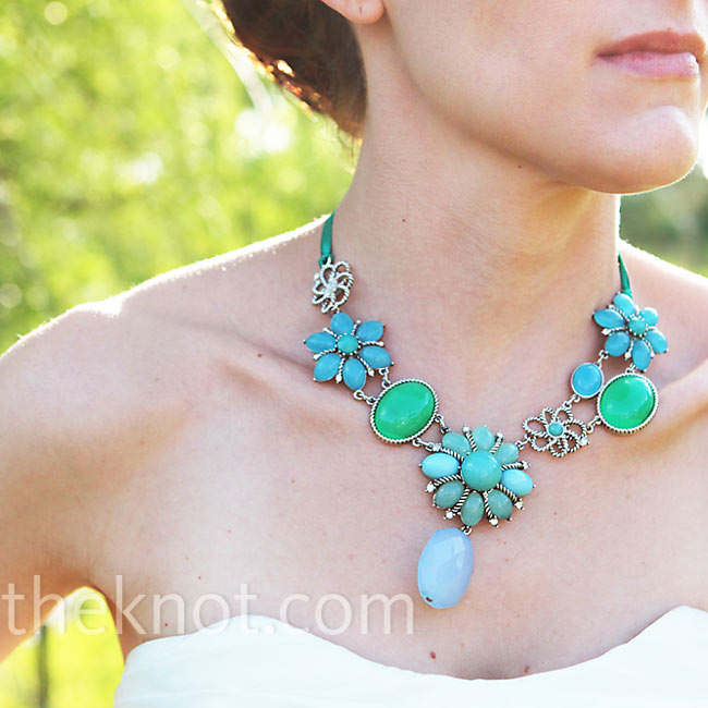 To give her look a pop of color, Brandi chose a fun turquoise necklace to add to her wedding day look for the reception.