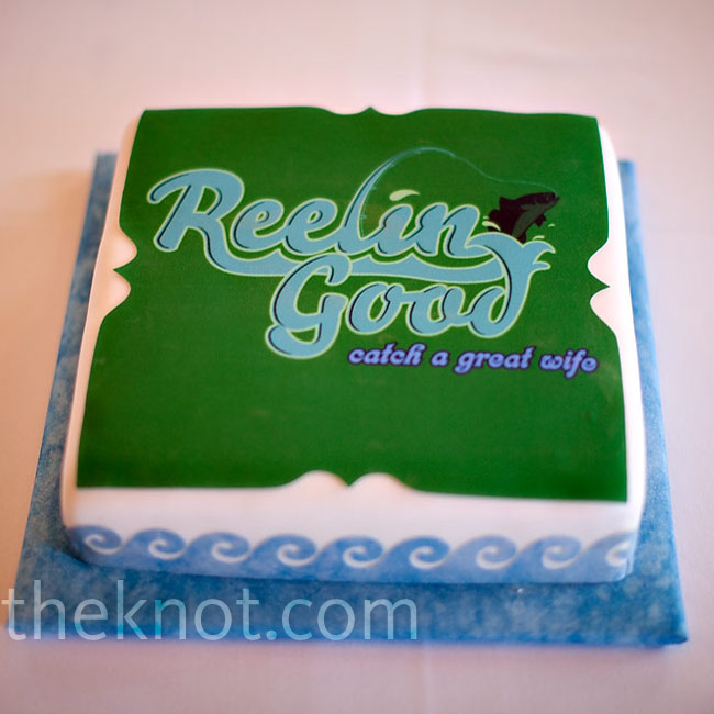 "Travis' groom's cake was a replica of his business logo (he's a fishing charter captain). His company's slogan is ""Catch a Good Time,"" so the baker changed it to ""great wife"" for a cute play on words."