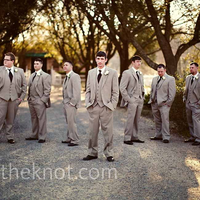 Travis and his six groomsmen wore tan suits with matching tan vests, chocolate ties, and dark brown shoes.