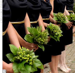 The bridesmaids wore navy cowl neck dresses accessorized with gold belts from J. Crew and earrings from Anthropologie. Deanna from Great Expectations created their bouquets -- green wheat, salal leaf, and green hypericum berries -- to pop against their dresses.