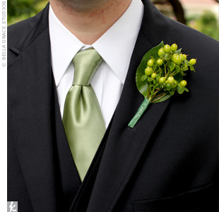 The groomsmen's simple boutonnieres were composed of green hypericum berries while the groom's boutonniere stood out with an extra salal leaf.