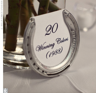 Each reception table was named after a past Kentucky Derby winner, and the table cards were placed inside silver horseshoe frames. They picked the winners from years that were significant to their families, such as the birth years of parents, grandparents, and siblings. The rest of the tables were named after particularly unique horses.